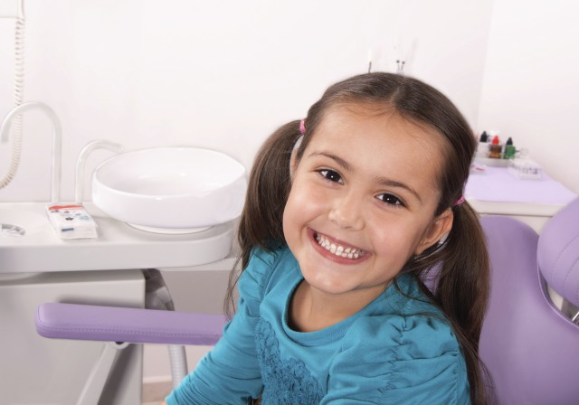 Little girl in the dental office